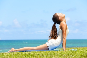 Fitness yoga woman stretching abdominal stomach muscles in cobra